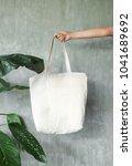 hand holding white blank linen... | Shutterstock . vector #1041689692