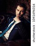 respectable handsome man in... | Shutterstock . vector #1041696316