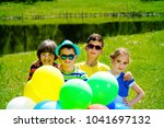 group of cheerful children... | Shutterstock . vector #1041697132