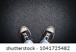 a teenager in jeans and canvas... | Shutterstock . vector #1041725482