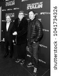 Small photo of New York, NY - March 8, 2018: Armando Iannicci, Michael Moore and Jason Isaacs attend New York premiere of IFC Film Death of Stalin at AMC Lincoln Square