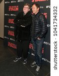 Small photo of New York, NY - March 8, 2018: Michael Moore and Jason Isaacs attend New York premiere of IFC Film Death of Stalin at AMC Lincoln Square