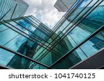 modern office building against... | Shutterstock . vector #1041740125