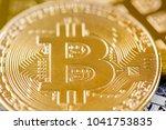 golden bitcoin coins on us... | Shutterstock . vector #1041753835