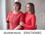 daughter hugs mature mother... | Shutterstock . vector #1041765682