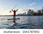 adventurous man is paddle... | Shutterstock . vector #1041787852