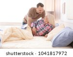 senior couple getting up in... | Shutterstock . vector #1041817972