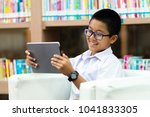 asian student is watching movie ... | Shutterstock . vector #1041833305