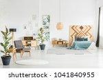 grey armchair in spacious... | Shutterstock . vector #1041840955