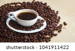 a cup of coffee  background   Shutterstock . vector #1041911422