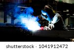 welding with sparks by process... | Shutterstock . vector #1041912472