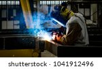 welding with sparks by process... | Shutterstock . vector #1041912496