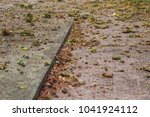 concrete driveway covered in... | Shutterstock . vector #1041924112