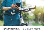 cyclist use cellphone while... | Shutterstock . vector #1041947596