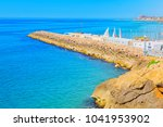 view of the beach and the sea...   Shutterstock . vector #1041953902