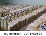 heaps of outdated catalogues in ... | Shutterstock . vector #1041960688