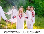 midsummer. a group of young... | Shutterstock . vector #1041986305