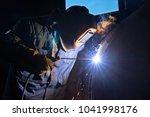 welder in the mask and... | Shutterstock . vector #1041998176
