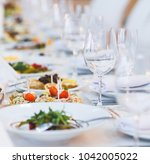 beautifully served table in a... | Shutterstock . vector #1042005022