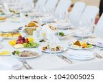 beautifully served table in a... | Shutterstock . vector #1042005025