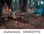 chops tree in wood with sharp... | Shutterstock . vector #1042024792