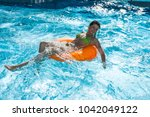 sexi lady in swimming pool on... | Shutterstock . vector #1042049122
