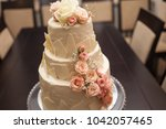 gorgeous cake covered in roses... | Shutterstock . vector #1042057465