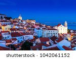 sight of alfama in lisbon ... | Shutterstock . vector #1042061152