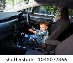 cute little boy driving fathers ...   Shutterstock . vector #1042072366