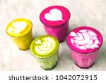 four different cups of colored... | Shutterstock . vector #1042072915