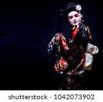 geisha in kimono on black | Shutterstock . vector #1042073902