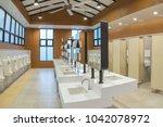 row of modern white ceramic... | Shutterstock . vector #1042078972