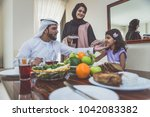 arabic happy family lifestyle... | Shutterstock . vector #1042083382