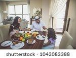 arabic happy family lifestyle...   Shutterstock . vector #1042083388