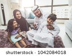arabic happy family lifestyle... | Shutterstock . vector #1042084018