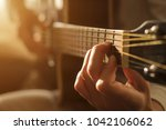 playing acoustic guitar | Shutterstock . vector #1042106062
