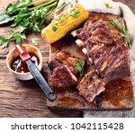 pork ribs with corn on a wooden ... | Shutterstock . vector #1042115428