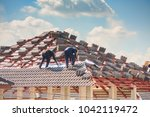 house construction. roofers... | Shutterstock . vector #1042119472