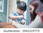cute little girl and her... | Shutterstock . vector #1042119775