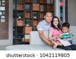 portrait of family spending... | Shutterstock . vector #1042119805