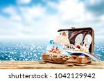 brown old suitcase on wooden... | Shutterstock . vector #1042129942