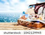 brown old suitcase on wooden... | Shutterstock . vector #1042129945