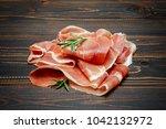 italian prosciutto crudo or... | Shutterstock . vector #1042132972