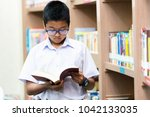 asian student is searching for... | Shutterstock . vector #1042133035