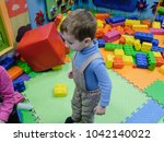 happy laughing boy having fun... | Shutterstock . vector #1042140022