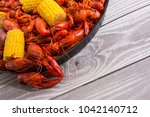boiled crawfish on a black tray | Shutterstock . vector #1042140712