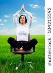 beautiful businesswoman relaxing in armchair at the field - stock photo