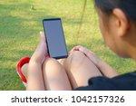 female hand holding the... | Shutterstock . vector #1042157326
