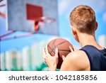 male playing basketball outdoor | Shutterstock . vector #1042185856