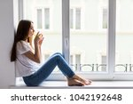 smiling girl with glass of... | Shutterstock . vector #1042192648